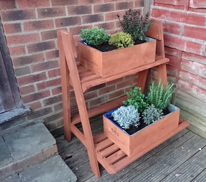 plant boxes on shelves from recycled wooden pallet