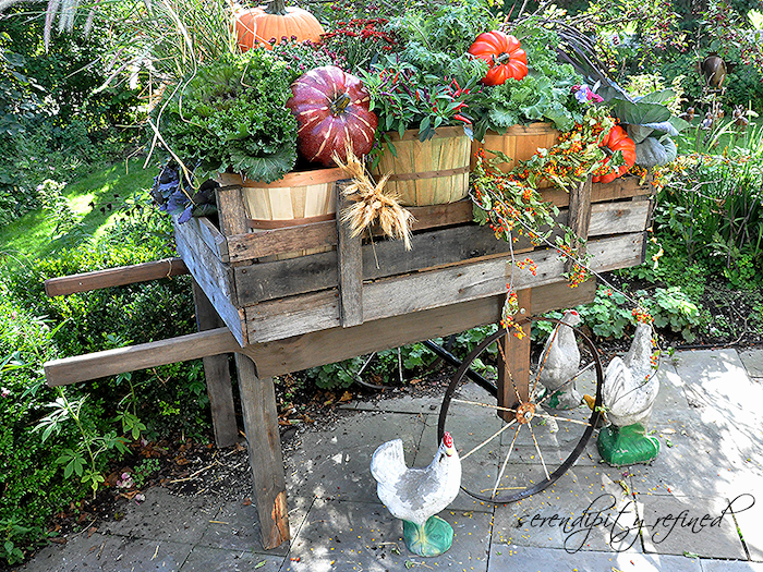 rustic cart made from wood pallets into a pallet vegetable garden